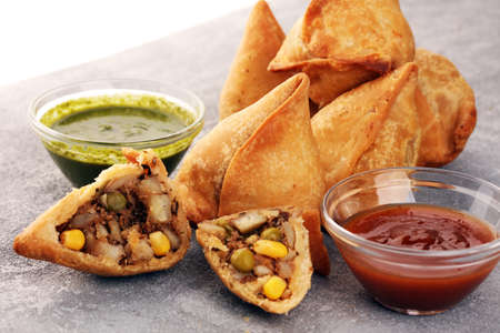 Vegetarian samsa or samosas.Indian special traditional street food punjabi samosa or Coxinha, Croquete and other Fried Brazilian Snacks. traditional fried food