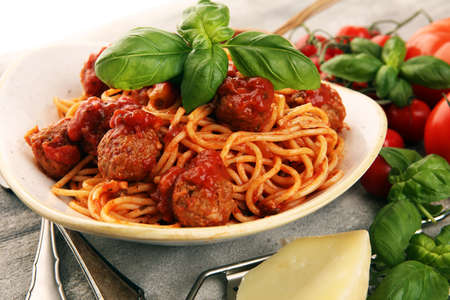 Spaghetti pasta with meatballs and tomato sauce, with parmesan and basil 스톡 콘텐츠