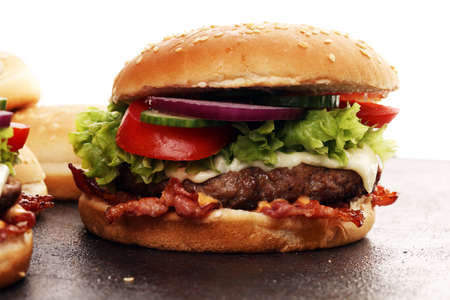Tasty fresh meat burgers with salad and cheese. Homemade angus burger with salad.