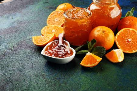 mandarin homemade jam marmelade in a glass jar. fresh juicy jelly Reklamní fotografie