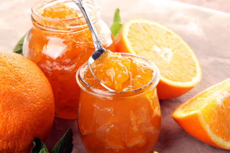 orange homemade jam marmelade in a glass jar. fresh juicy jelly