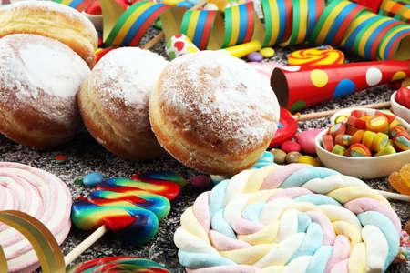 Carnival powdered sugar raised donuts with paper streamers. German berliner or krapfen 版權商用圖片