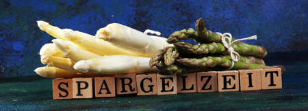 Healthy fresh White and green asparagus on vintage background with Spargelzeit wooden letter.  版權商用圖片