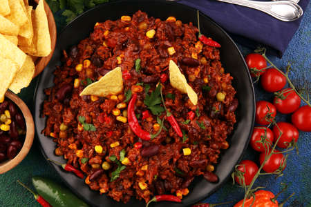 Hot chili con carne. mexican food tasty and spicy with pepper and kidneys
