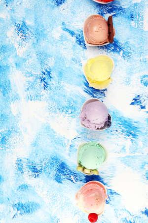 Various of ice cream flavor with fresh blueberry, strawberry, kiwi, lemon, vanilla setup on rustic background . Summer and Sweet ice cream