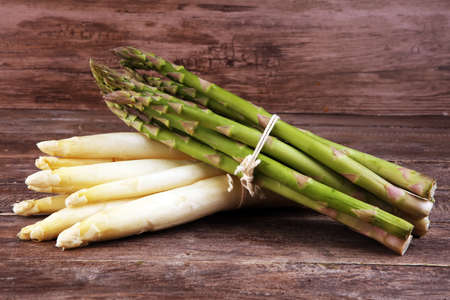 Healthy fresh White and green asparagus on vintage background