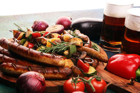 Assorted delicious grilled meat with vegetable on a barbecue with Grilled pork shish or kebab on skewers with vegetables . Food background and sausages