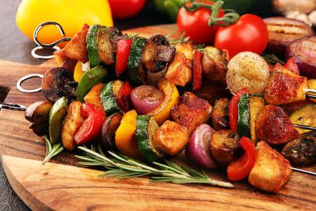 Grilled pork shish or kebab on skewers with vegetables . Food background shashlik or chicken skewers 写真素材