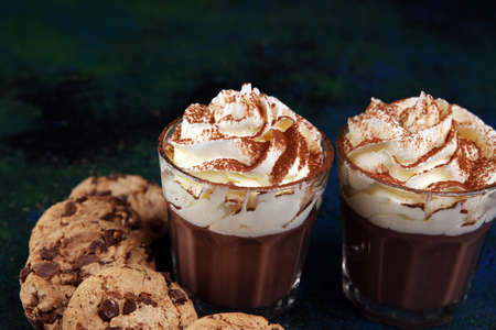 hot chocolate with cocoa and chocolate chip cookies with whipped cream