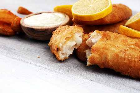 traditional British fish and chips consisting of fried fish, potato chips. fish to takeaway