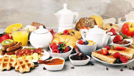 Breakfast served with coffee, orange juice, croissants, cereals and fruits. Balanced diet. Continental breakfast with granola Stock Photo