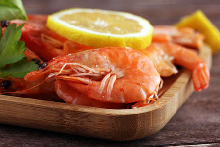 Raw fresh Prawns Langostino Austral. shrimp seafood with lemon and spices on table Stock fotó