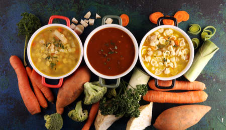 Set of three soups from worldwide cuisines, healthy food. Broth with noodles, beef soup and broth with marrow dumplings. All soups with healthy vegetables.