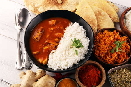Chicken tikka masala spicy curry meat food in pot with rice and naan bread. indian food with chicken and curry