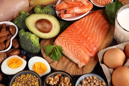 healthy eating and diet concept - natural rich in protein food on table