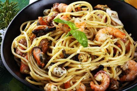 Seafood pasta. Dish with mediterranean frutti di mare on rustic table