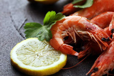 Raw fresh Prawns Langostino Austral. shrimp seafood with lemon and spices on table