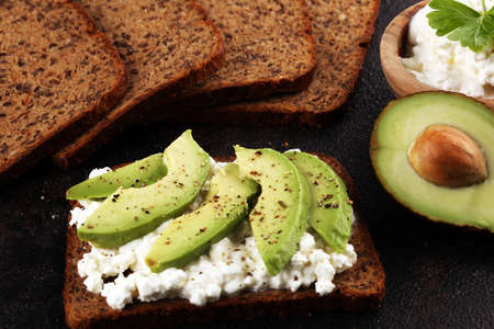 Sandwich with avocado and grained cream cheese for a healthy breakfast concept