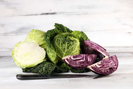 Three fresh organic cabbage heads. Antioxidant balanced diet eating with red cabbage, white cabbage and fresh savoy