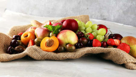 Fresh summer fruits with apple, grapes, berries, plums and organic apricot. Stockfoto