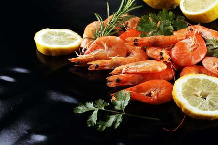 Raw fresh Prawns Langostino Austral. shrimp seafood with lemon and spices. 스톡 콘텐츠
