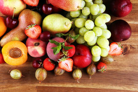 Fresh summer fruits with apple, grapes, berries, plums and organic apricot.