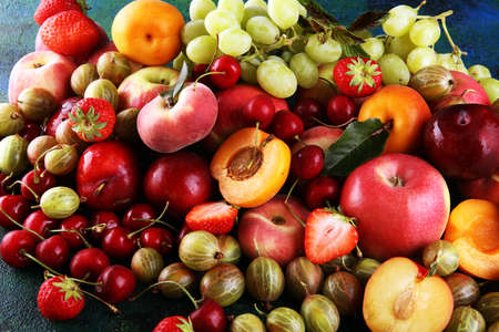 Fresh summer fruits with apple, grapes, berries, plums and organic apricot. Reklamní fotografie