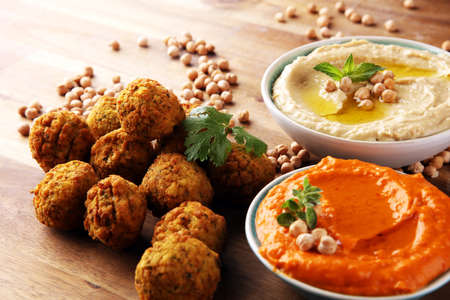 Traditional homemade hummus, falafel and chickpea on background. Jewish Cuisine.