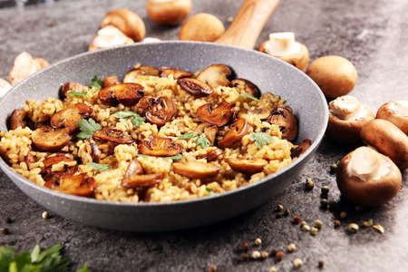 risotto with mushrooms, fresh herbs and parmesan cheese and basil