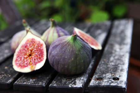 Fresh figs. Food Photo. whole and sliced figs fruits on rustic background