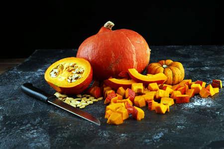 Pumpkin and pumpkin slices Autumn Healthy Food Nutrition Seasonal Vegetable Concept Zdjęcie Seryjne