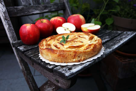 Apple tart. Gourmet traditional holiday apple pie sweet baked dessert food with cinnamon and apples on table for dessert Reklamní fotografie