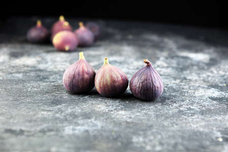 Fresh figs. Food Photo. Whole and sliced figs on rustic background