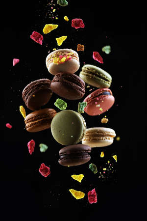 Sweet and colorful french macaroons or macaron on dark background Stock fotó