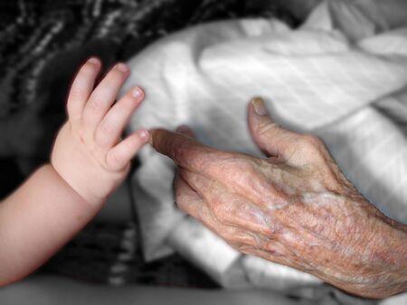 centenarian: Intergenerational Hands Stock Photo