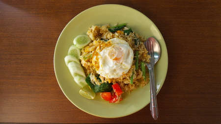 rice plate: Fried rice with fried chicken on wood table