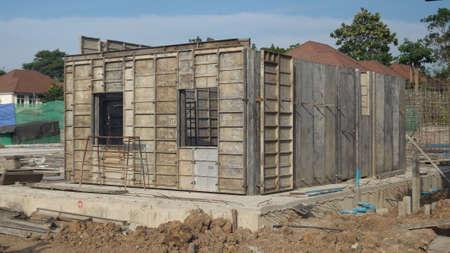 tilt view: Tilt view of the houses construction in daytime