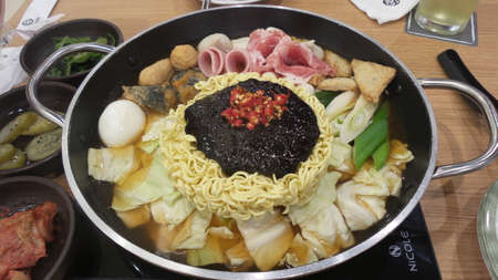 a traditional korean: Tokpokki is a traditional Korean food, hot pot style.