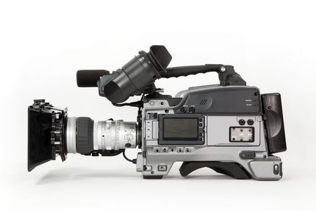 def: A professional high definition, tapeless broadcast camcorder. Shown with matte box and battery, isolated on white Stock Photo