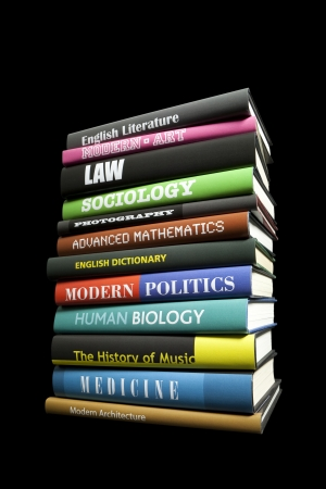 pile of books: Real book subjects on black Stock Photo