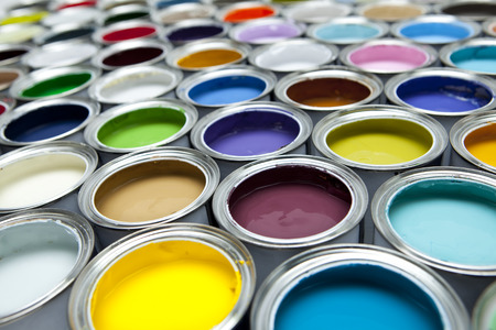 decorating: Colourful paint tins Stock Photo