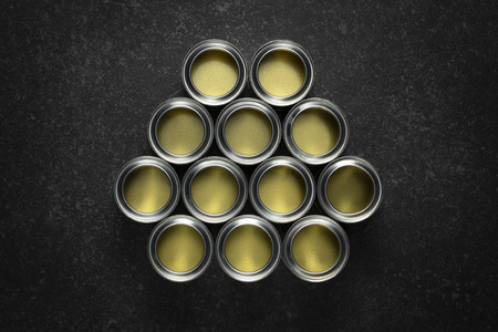 Arrangement of 12 empty open paint cans on black marble background. Stok Fotoğraf