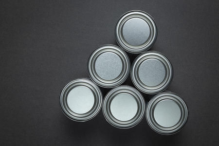 Metal paint tins with lids on granite background. Stok Fotoğraf