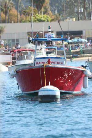 A red harbor partol boat sits at its mooring