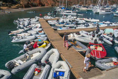 Early on Buccanners Weekend 2009 at the Isthmus, Two Harbors, Catalina Island, California, showing the crowded docks with colorful dinghies and sailboats Editöryel
