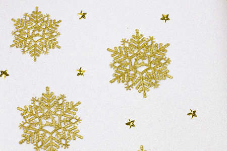 star ornament: Golden snow flakes with glittering white background. Christmas theme