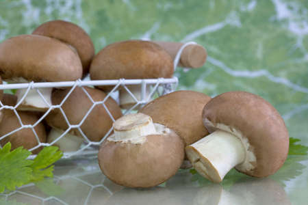 edible: edible, fresh and tasty brown button mushrooms Stock Photo