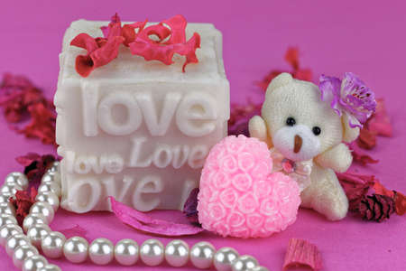 love box: Small teddy bear with Love box.  Pink Background. Valentines theme