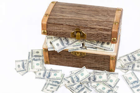 treasure trove: full of money in wooden treasure chest