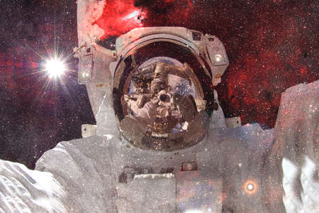 Astronaut. Nebula, cluster of stars in deep space. Science fiction art. Stok Fotoğraf